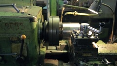 At the factory old horizontal lathe aligns layer of metal parts Stock Footage