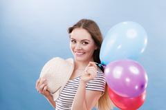 Woman summer joyful girl with colorful balloons Stock Photos