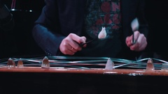 Man plays on hammered dulcimer in a theatre. Stock Footage