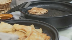 Cooking traditional russian pancakes on a skillet Stock Footage