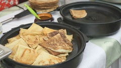 Traditional russian pancakes on a skillet Stock Footage