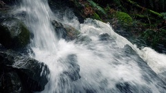 Waterfall In Forest With Snow On The Rocks Stock Footage