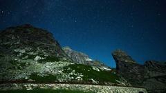 Great St Bernard Pass alps switzerland mountains timelapse stars night Stock Footage