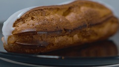 Fresh from the bakery - French Eclair pastry Stock Footage