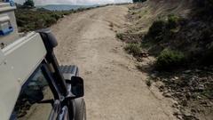 Drive off-road coast dirt track 4x4 camoervan Stock Footage