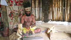 Local Man in Traditional Dress Creates Handicrafts at Taman Nusa Cultural Par Stock Footage