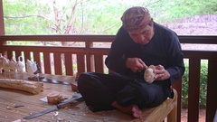 Local man carves traditional, Balinese Theater Puppet. Taman Nusa Cultural Pa Stock Footage