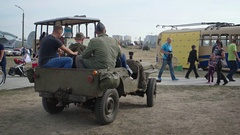 Tourists take Rides in Restored Army Jeep at Classic Car Show and Air Fair Stock Footage