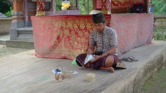 Local Artist Demonstrates Painting on Ostrich Eggs at Taman Nusa Cultural Par Stock Footage