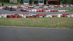 Tourists Enjoying a Go Cart Race Track at a Local Park Stock Footage