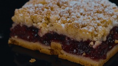 Fresh from the bakery - cherry crumb cake in a close up shot Stock Footage