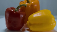 A variety of bell peppers on a turntable Stock Footage