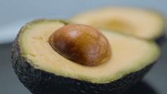 Sliced Avocado - very healthy fruit - close up shot Stock Footage