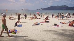 Happy Tourists on the Warm Tropical Beach with Cruise Ship in the Background Stock Footage