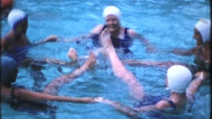 Synchronized swimmers practice their routine in the pool 4002 vintage home movie Stock Footage