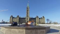 Ottawa parliament centennial flame and tourists 4k Stock Footage