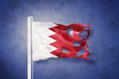 Flag of Bahrain flying against grunge background Stock Illustration