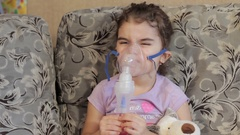 The girl does not want to do inhalation. Indulge during the procedure. Wrinkle Stock Footage