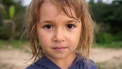 Portrait adorable 5 year old girl with wet hair outdoor Stock Footage