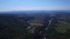 Aerial flight over Polovragi commune and green hills, Romania Stock Footage