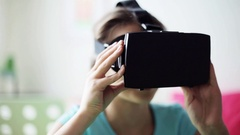 Happy girl in vr headset or 3d glasses at home Stock Footage
