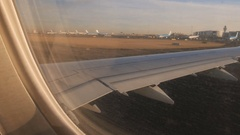 Take off at Schiphol Airport filmed from the plane window Stock Footage