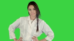 Smiling young woman in lab coat making funny dance on a Green Screen, Chroma Key Stock Footage