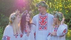 Midsummer. A group of young people of Slavic appearance at the celebration of Stock Footage