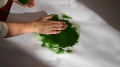 Person smears paint paper Stock Footage