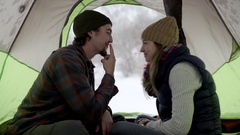 Man Gestures For His Girlfriend To Give Him A Kiss, She Gives Him A Cute Kiss Stock Footage
