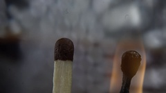 Wooden match burning on a dark background Stock Footage