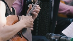 Woman playing a little guitar Stock Footage