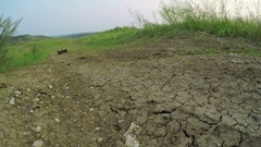 Radio-controlled machine rides on the dirt road Stock Footage