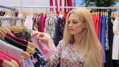 Young adults girl in good mood shopping at the clothing store Stock Footage