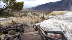 Walking down from the top of mammoth hot springs, in Yellowstone national p.. Stock Footage
