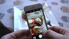 Take a photo of breakfast food with mobile phone camera for social network Stock Footage