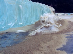 Sculpted Ice Chunk in Silty Snow Formation Low Pullback Stock Footage