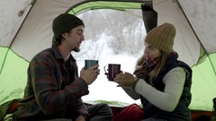 Cute Adventurous Couple On Winter Camping Trip, Cheers With Hot Cocoa Stock Footage