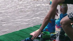 Man fixing wakeboard bindings Stock Footage