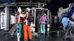 Skiers waiting in the station a cable car to climb the piste and when comes u Stock Footage