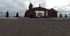 Aerial view Gate and entrance to Orthodox Church on background of field in snow Stock Footage