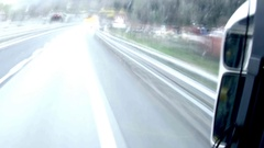 Timelapse view through the windshield of a truck passing through a tunnel lit Stock Footage