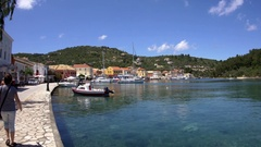 View of the port of the island Gaios Paxo with old houses boats moored to the Stock Footage