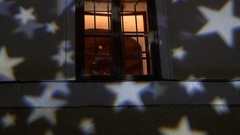 White stars that are projected on the wall of a house where the lights can be Stock Footage