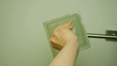 Female hand changing an old incandescent ceiling light bulb with a new energy Stock Footage
