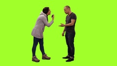 Jealous wife yelling at her husband on green screen background, Full HD shot Stock Footage