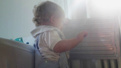 Baby playing plastic container Lens flare hitting camera Stock Footage