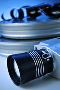 Film camera and movie film reel canisters Stock Photos