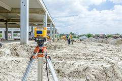 Modern device makes measurements with red laser level tool Stock Photos