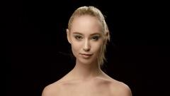 Ukrainian fashion model closeup isolated on black background. Beautiful model Stock Footage